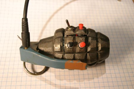 an mp3 player made out of a grenade casing